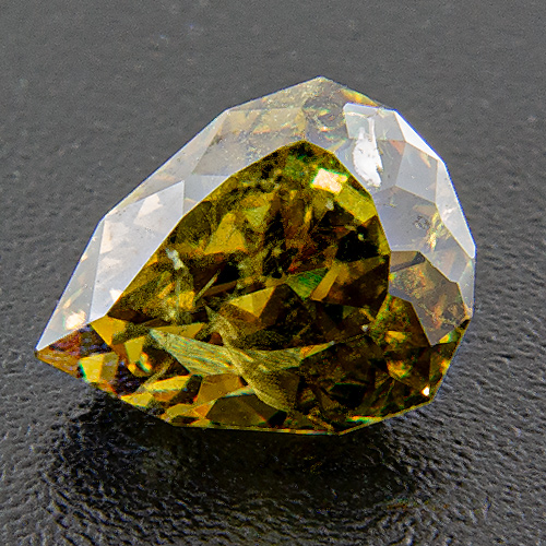 Colour change demantoid from Namibia. 0.98 Carat. Pear, distinct inclusions