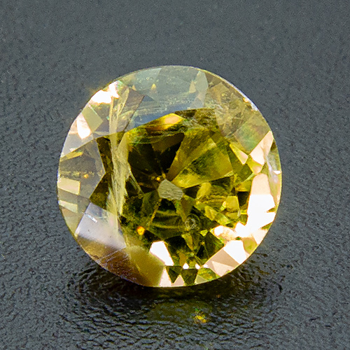 Yellow Sapphire from Australia. 0.66 Carat. Round, very distinct inclusions