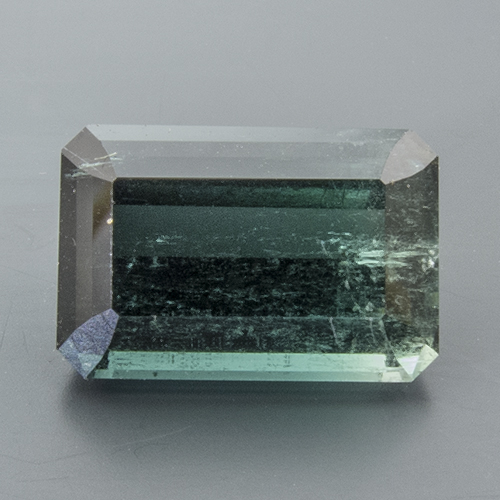 Tourmaline (Indigolite) from Namibia. 5.1 Carat. Emerald Cut, very distinct inclusions