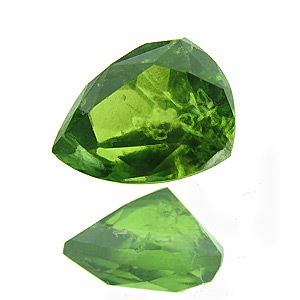 Vesuvianite (Idocrase) from Ethiopia. 0.54 Carat. new location in sidamo province/ethiopia. the colour is typical for chrome 