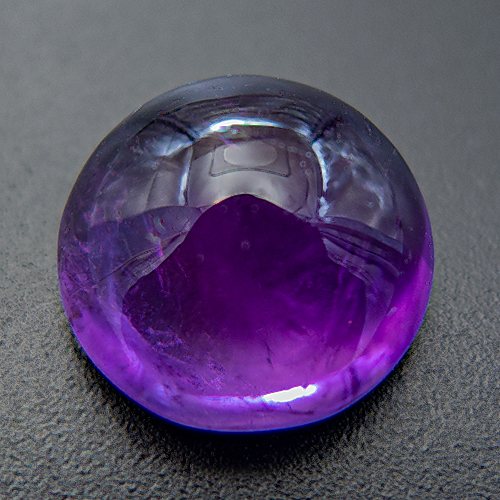Amethyst from Zambia. 1 Piece. Cabochon Round, very, very distinct inclusions