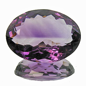 Amethyst from Zambia. 18.49 Carat. the colour zoning is much less prominent in reality
