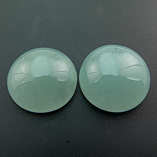 Aquamarine from Africa. 42.8 Carat. Dimensions 18,8x8,7 & 18,5x7,8mm; slight difference in hight can be adjusted with the setting
