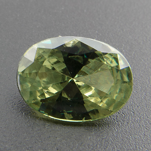 Demantoid garnet from Namibia. 0.91 Carat. Oval, very very small inclusions