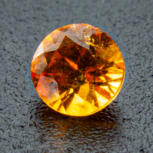 Mandarine Garnet from Namibia. 0.19 Carat. Round, very distinct inclusions