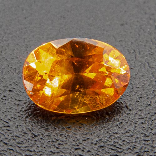 Mandarin Garnet from Namibia. 0.3 Carat. Oval, very distinct inclusions