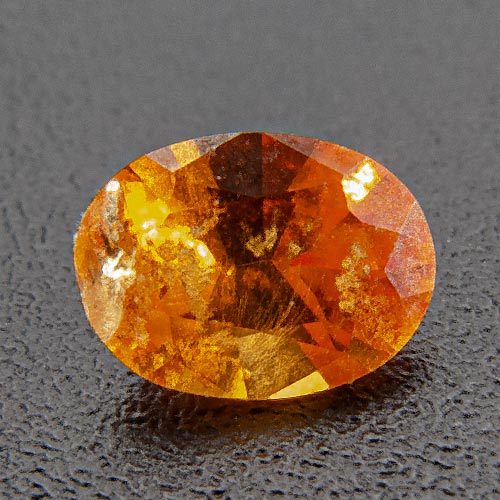 Mandarine Garnet from Namibia. 0.37 Carat. Oval, distinct inclusions