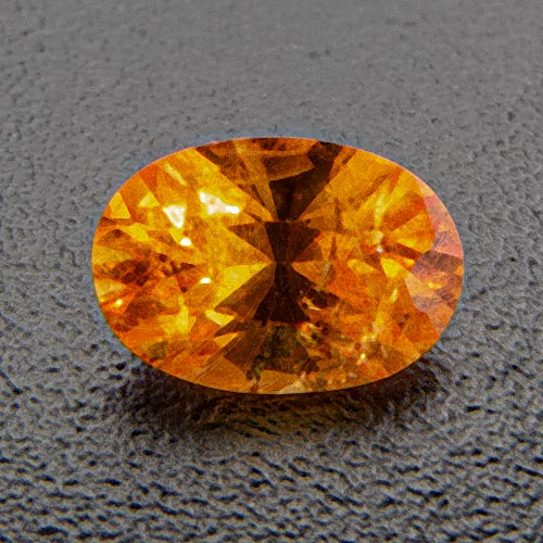 Mandarin Garnet from Namibia. 0.38 Carat. Oval, distinct inclusions