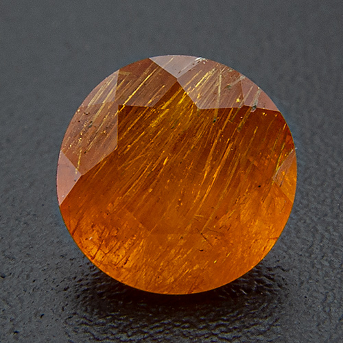 Mandarine Garnet from Namibia. 0.62 Carat. Round, very, very distinct inclusions