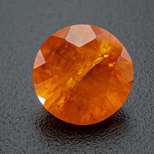 Mandarine Garnet from Namibia. 0.81 Carat. Round, very, very distinct inclusions