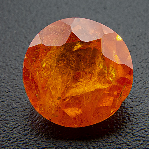 Mandarine Garnet from Namibia. 1.02 Carat. Round, very, very distinct inclusions