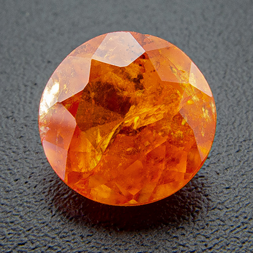 Mandarine Garnet from Namibia. 1.17 Carat. Round, very, very distinct inclusions