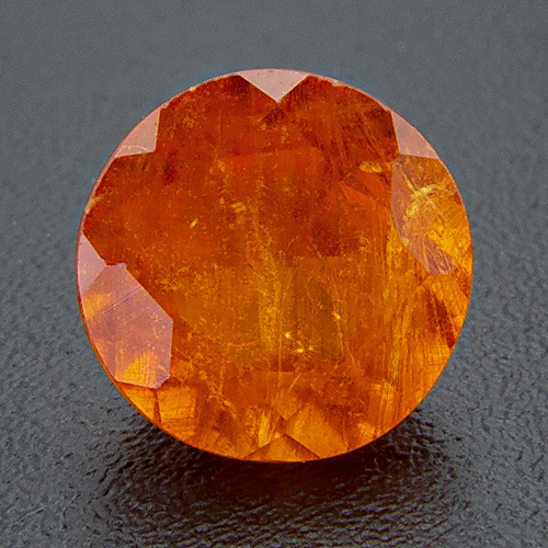 Mandarine Garnet from Namibia. 1.21 Carat. Round, very, very distinct inclusions