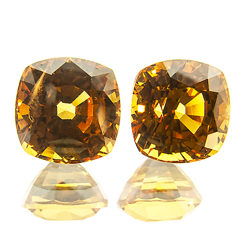 Spessartine Garnet from Nigeria. 3.1 Carat. very attractive, well cut and lively pair. to the naked eye the inclusions are not nearly as prominent as on the strongly enlarged photo