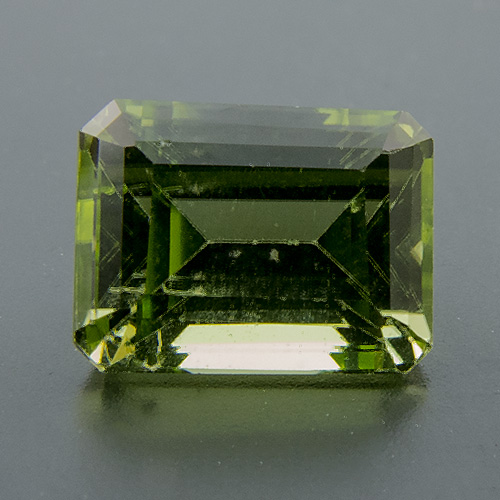 Peridot from Myanmar. 0.88 Carat. Emerald Cut, small inclusions