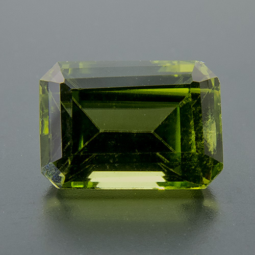 Peridot from Myanmar. 1.14 Carat. Emerald Cut, small inclusions