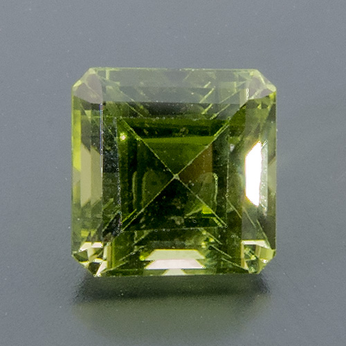 Peridot from Myanmar. 1 Piece. Emerald Cut, small inclusions