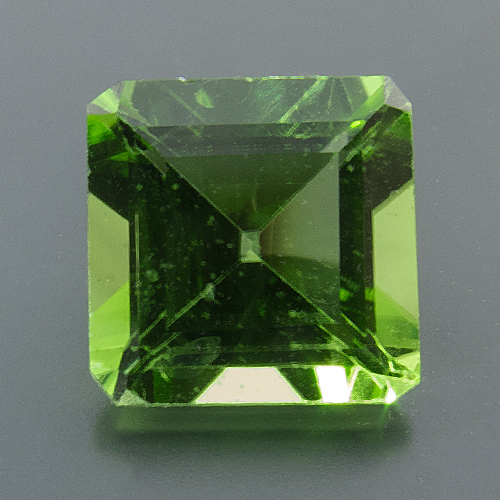 Peridot from Myanmar. 1 Piece. Emerald Cut, very small inclusions