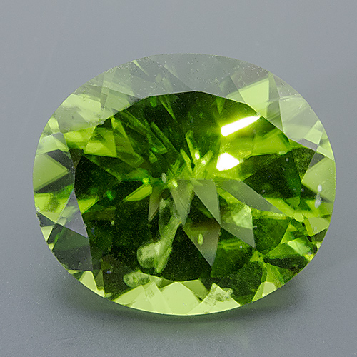 Peridot. 10.04 Carat. Oval, small inclusions