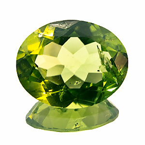 Peridot. 3.99 Carat. Oval, very distinct inclusions