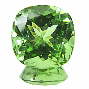 Peridot from Pakistan. 6.62 Carat. shows fine hairlike ludwigite needles, 