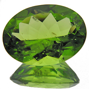 Peridot from Myanmar. 6.16 Carat. Oval, small inclusions