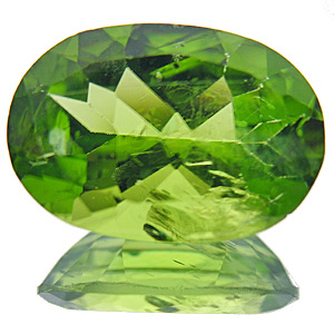 Peridot from Myanmar. 7.23 Carat. Oval, small inclusions