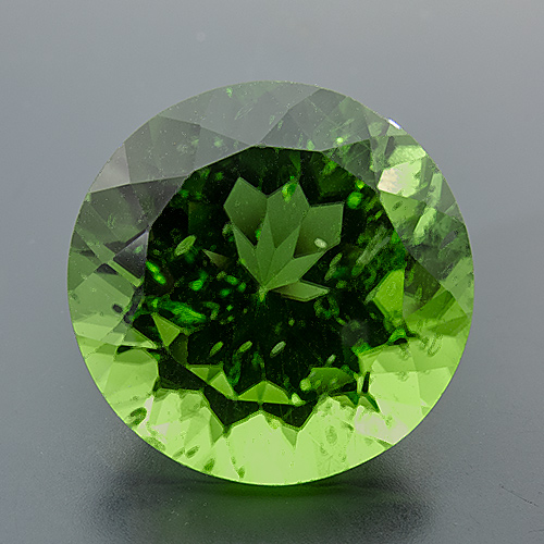 Peridot. 12.34 Piece. Round, small inclusions