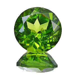 Peridot. 10.06 Carat. Round, small inclusions