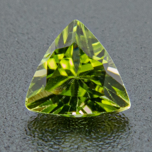 Peridot from China. 1 Piece. Trillion, very small inclusions