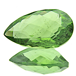 Peridot from Pakistan. 6.19 Carat. Pear Checkerboard, distinct inclusions