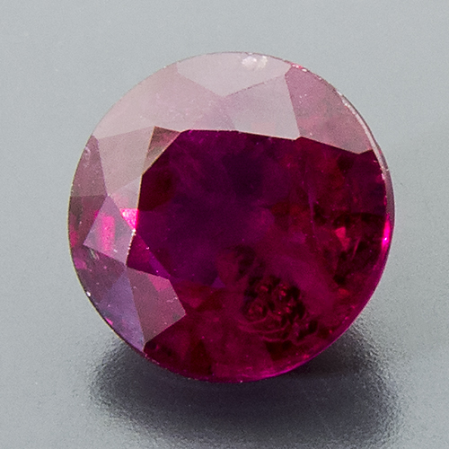 Ruby from Mozambique. 1.01 Carat. Round, very distinct inclusions