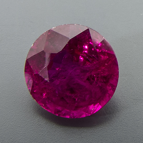 Ruby from Mozambique. 1.18 Carat. Round, very distinct inclusions
