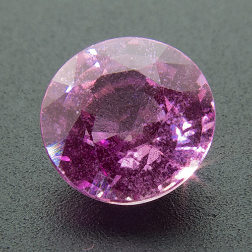 Pink Sapphire from Sri Lanka. 0.82 Carat. Round, distinct inclusions