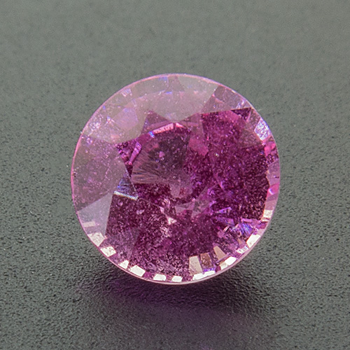 Pink Sapphire from Sri Lanka. 0.87 Carat. Round, distinct inclusions