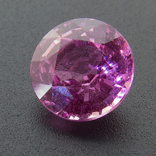 Pink Sapphire from Sri Lanka. 0.88 Carat. Round, distinct inclusions