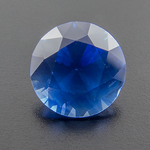 Sapphire from Sri Lanka. 0.76 Carat. This lovely gem owes it´s slightly velvety appearance to a cloud of rutile dust. However, this effect (unfortunately?) is not nearly as clearly visible to the naked eye as it is in the strongly enlarged photo.