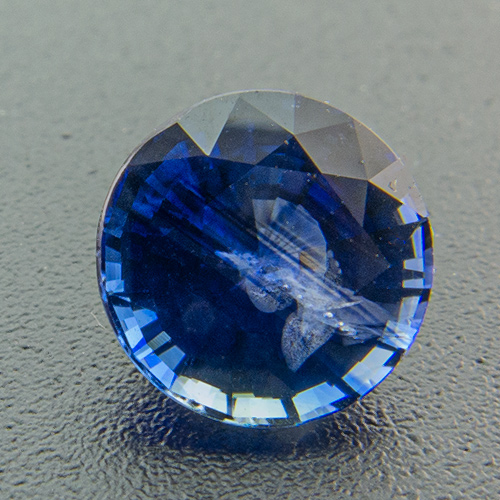 Sapphire from Madagascar. 0.99 Carat. Round, very distinct inclusions