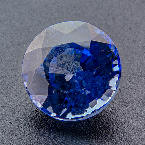 Sapphire from Sri Lanka. 0.91 Carat. Round, distinct inclusions
