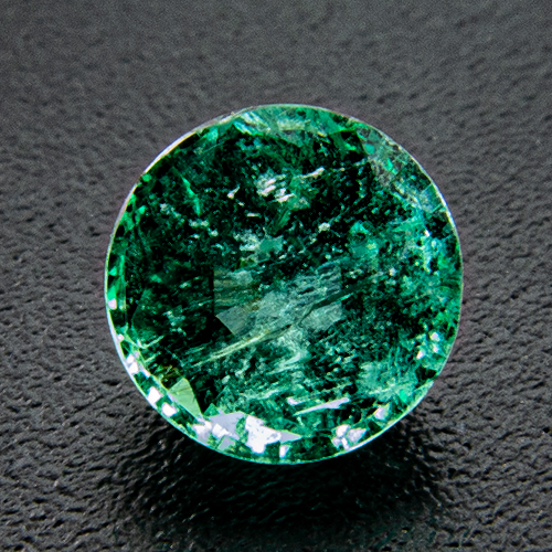 Emerald from Zambia. 0.54 Carat. Round, very distinct inclusions