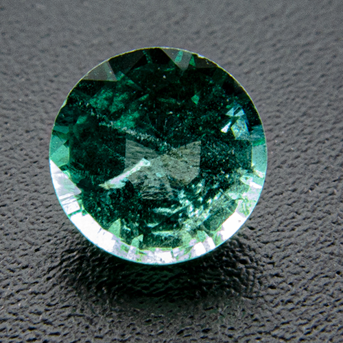Emerald from Zambia. 0.56 Carat. Round, very distinct inclusions