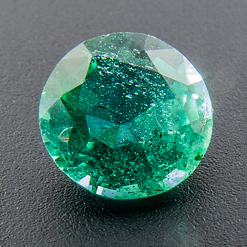 Emerald from Zambia. 0.49 Carat. Round, very distinct inclusions