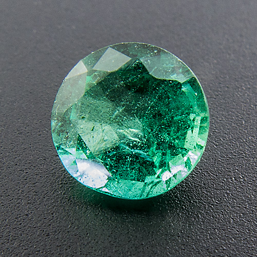 Emerald from Zambia. 0.57 Carat. Round, very distinct inclusions