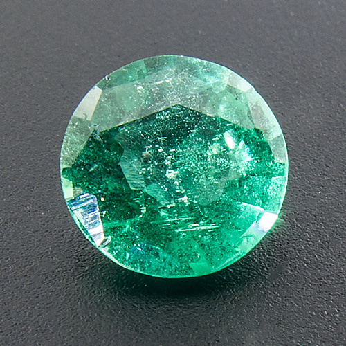 Emerald from Zambia. 0.62 Carat. Round, very distinct inclusions
