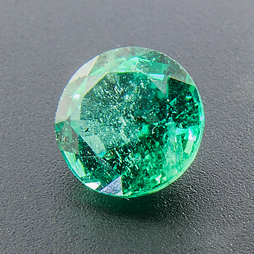 Emerald from Zambia. 0.7 Carat. Round, very distinct inclusions