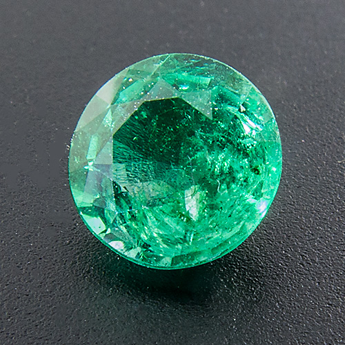 Emerald from Zambia. 0.73 Carat. Round, very distinct inclusions