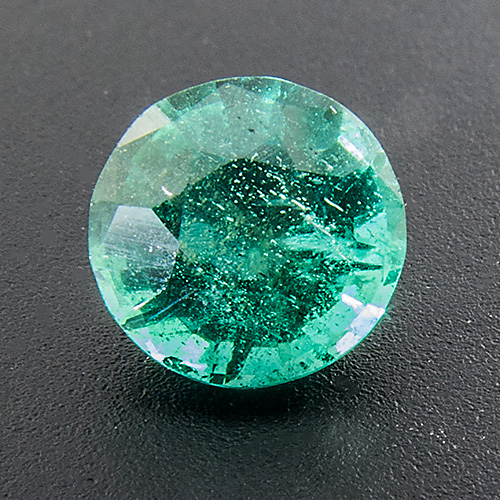 Emerald from Zambia. 0.75 Carat. Round, very distinct inclusions