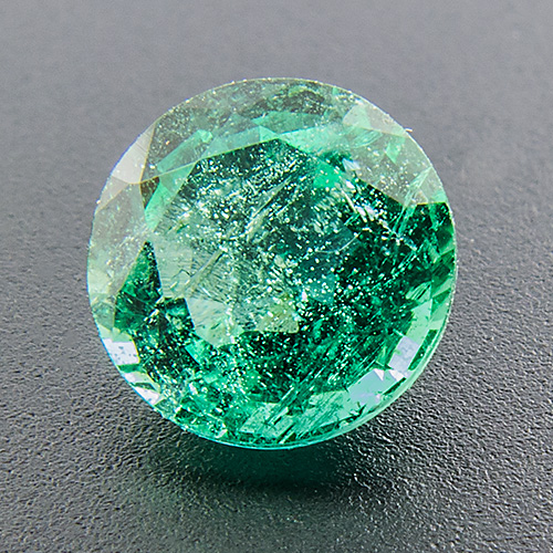 Emerald from Zambia. 0.79 Carat. Round, very distinct inclusions