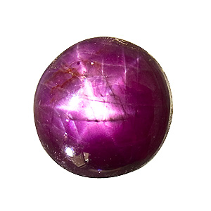 Star Ruby from India. 6.3 Carat. sharp star, very good colour. in reality this stone looks far better than on this enlarged photo