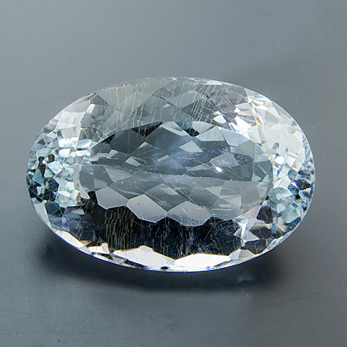 Natural Blue Topaz from Brazil. 13.54 Carat. sports several golden yellow, needle-shaped limonite inclusions